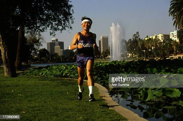 Portrait session with actor George Takei as he runs in Echo Park