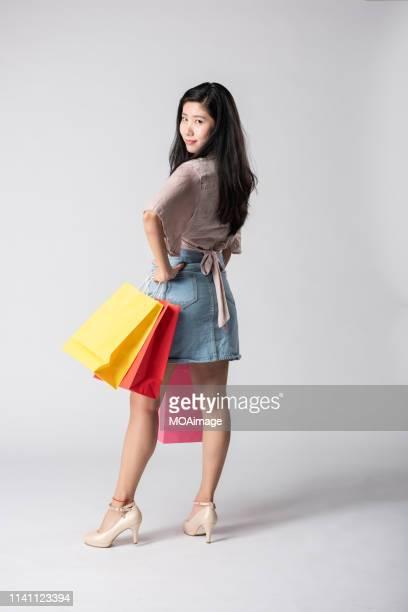 99d0e6004d Portrait shoot of a young Asian girl carrying a shopping bag