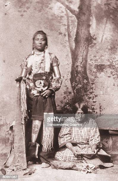 A portrait shows a Sioux medicine man and squaw early 20th century