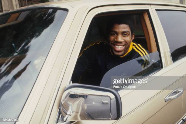 A portrait shows Los Angeles Lakers' center Earvin 'Magic' Johnson in his car NOTE TO USER User expressly acknowledges and agrees that by downloading...