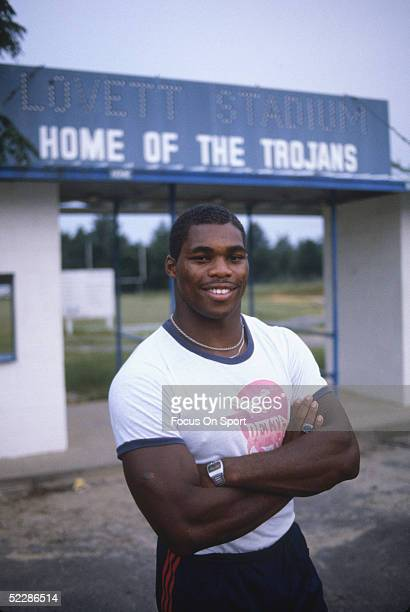A portrait shows University of Georgia Bulldogs' running back Herschel Walker as he poses for the camera infront of Lovett Stadium in 1981 Herschel...