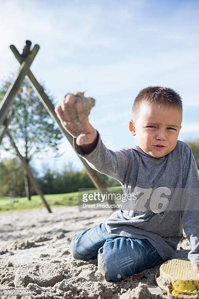 portrait small boy sand playing sandbox playground - spaß stock pictures, royalty-free photos & images