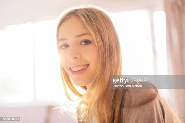 Portrait smiling blonde teenage girl