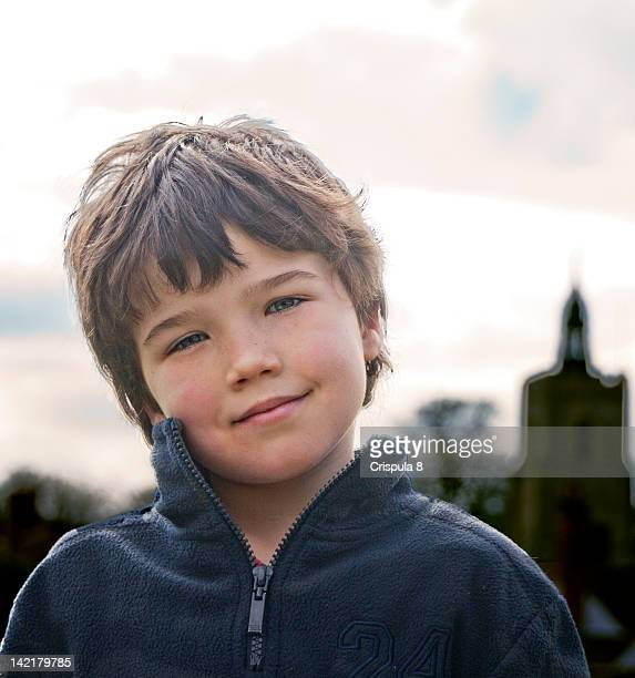 portrait smiling boy - head cocked stock pictures, royalty-free photos & images