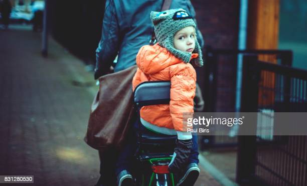 portrait smiling boy riding tandem bicycle, amsterdam - turning stock photos and pictures
