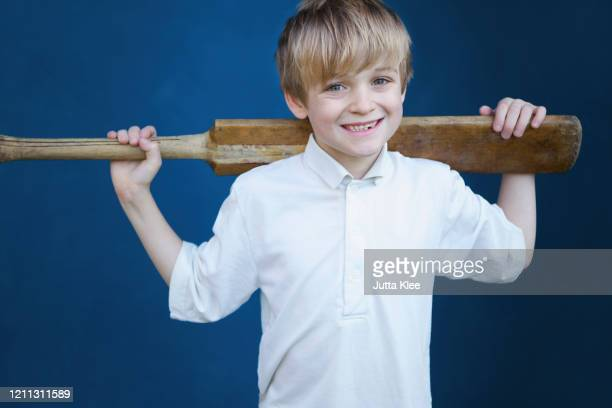 portrait smiling boy with cricket bat - cricket player stock pictures, royalty-free photos & images