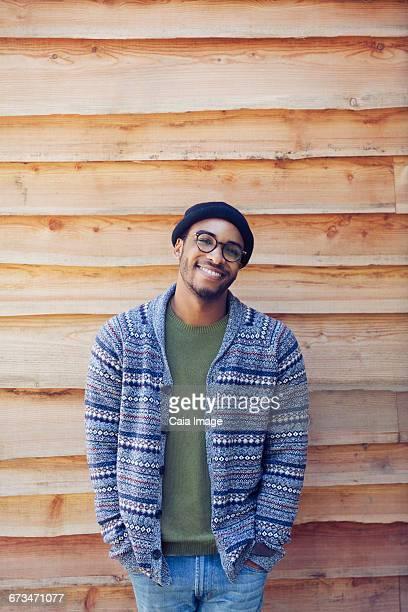 Portrait smiling man outside cabin