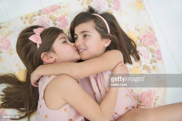 portrait smiling sisters hugging