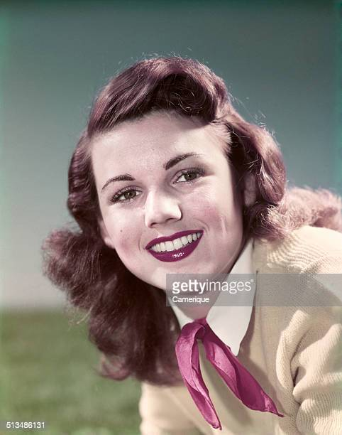 Portrait smiling teen girl wearing sweater red neckerchief tie Los Angeles California 1949