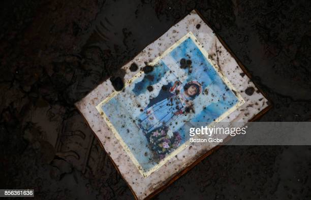 A portrait splattered with mud is seen on Avenida Calle Palma Villa Calma in Toa Baja Puerto Rico on Sept 30 2017 Puerto Rico was devastated by...