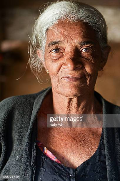 portrait sri lankan old woman selling bananas - sri lankan culture stock pictures, royalty-free photos & images