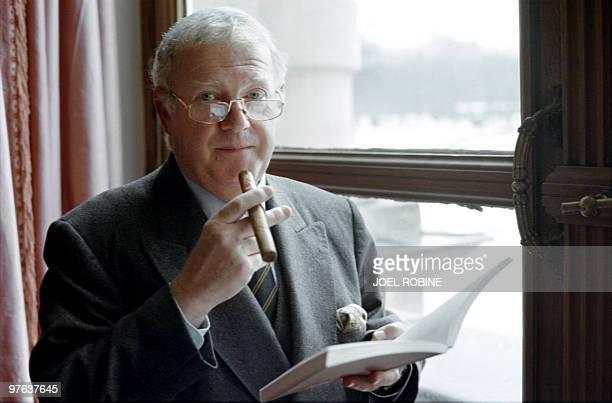 A portrait taken on December 17 1997 shows French senator and former Budget Minister Michel Charasse smoking a cigar at the Senat in Paris AFP PHOTO...