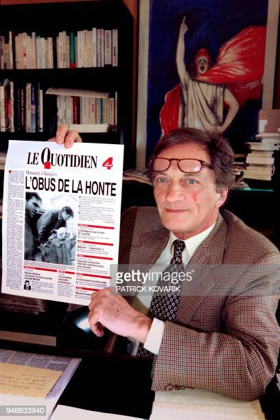 Portrait taken on March 17 1994 shows French journalist Philippe Tesson founder of the newspaper Le Quotidien de Paris showing the new print edition...