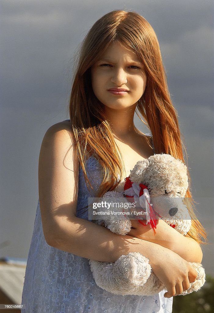 teen-girl-holding-tey-bear-girl