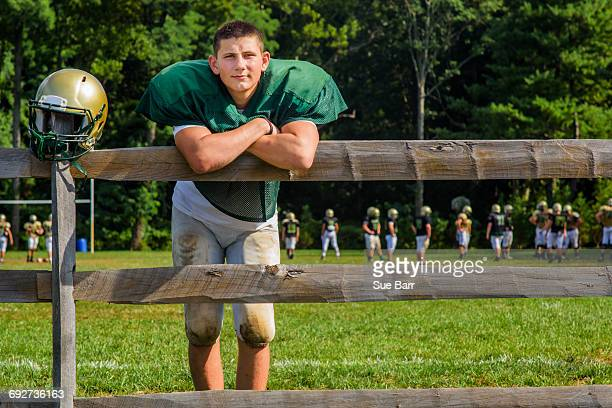 portrait teenage male american football player with helmet at playing field - safety american football player stock pictures, royalty-free photos & images