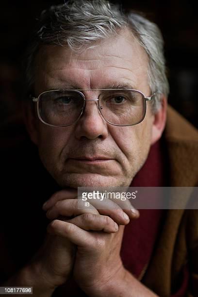 Portrait thoughtful men in glasses