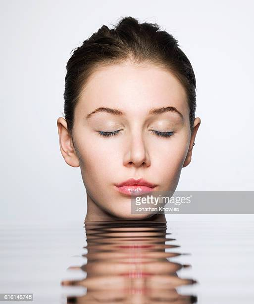 Portrait through water with ripples, eyes closed