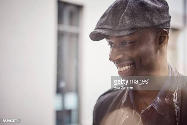portrait through window of a smiling man