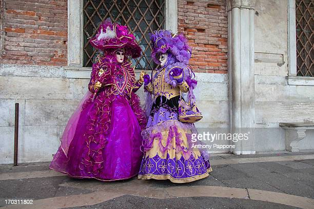 Portrait to the masked, carnival of venice, in St. Mark's Square, italy