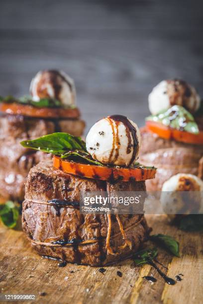 portrait view of beef filet served with tomato and mozzarella - easter dinner stock pictures, royalty-free photos & images