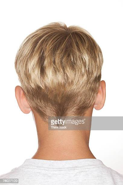 Portrait view of the back of a young blond haired boy's head.
