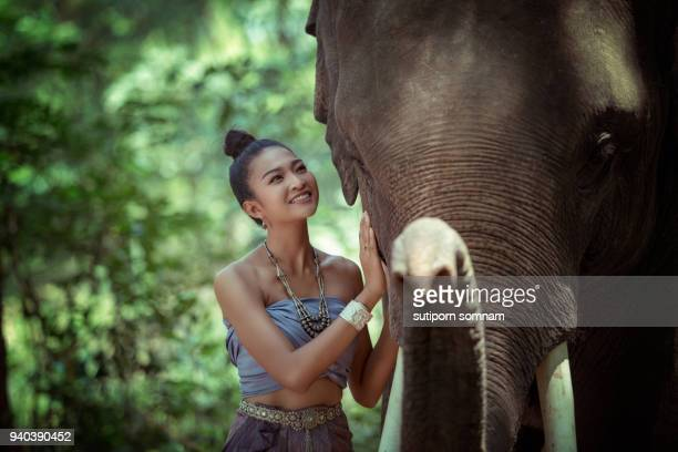 portrait woman and elephant