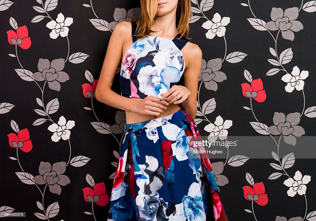 portrait woman wearing print dress on print back : Foto de stock