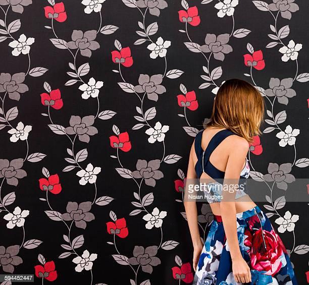 portrait woman wearing print dress on print back