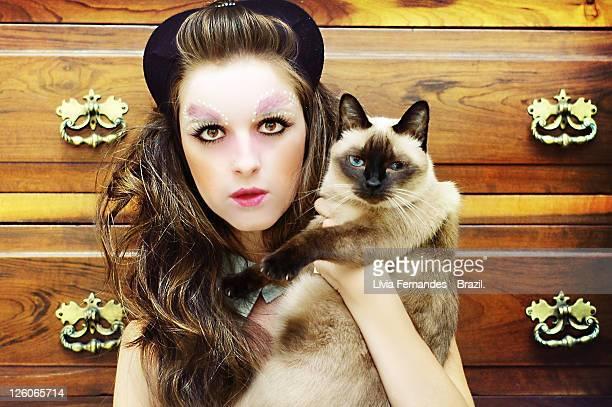 Portrait woman with cat