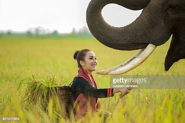 Portrait woman with elephant