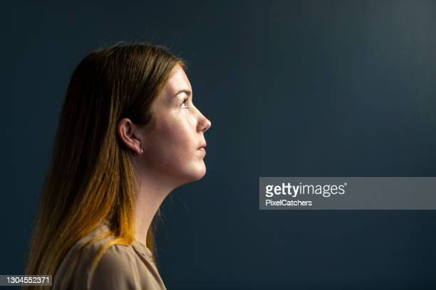 portrait young businesswoman looking towards the light - dark stock pictures, royalty-free photos & images