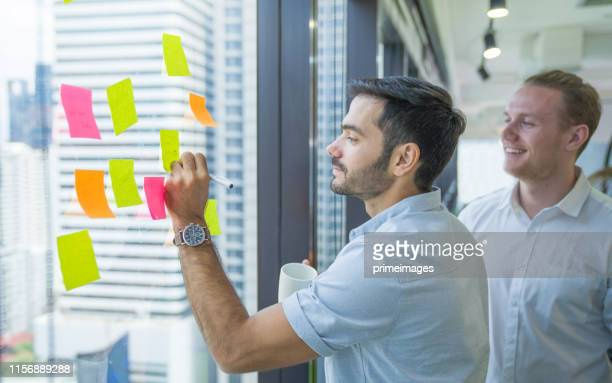 portrait young creative business person working success project with team business people weare casual suit outfit working happy action in modern coworking space - financial technology stock pictures, royalty-free photos & images