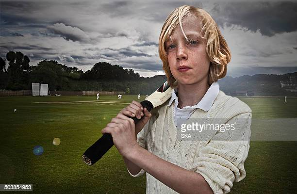 portrait, young male cricketer with bat