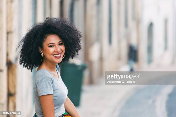 Portrait young woman smiling on street