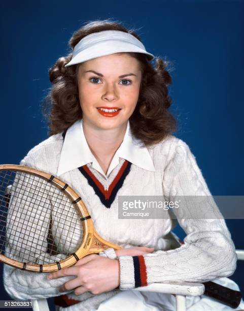Portrait young woman wearing tennis outfit visor holding racquet Los Angeles California 1949