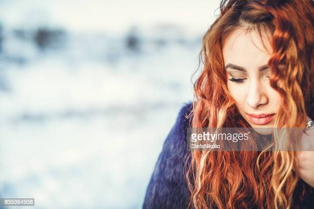 portraite of redhead girl on winter - little girl giving head stock photos and pictures