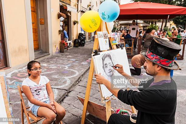 portraitist in piazza (square) santo spirito - caricature stock pictures, royalty-free photos & images