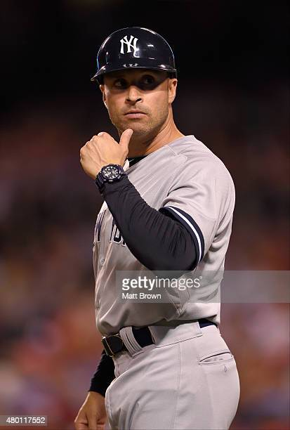 A portraitlike view of third base coach Joe Espada of the New York Yankees the seventh inning of during the game against the Los Angeles Angels of...