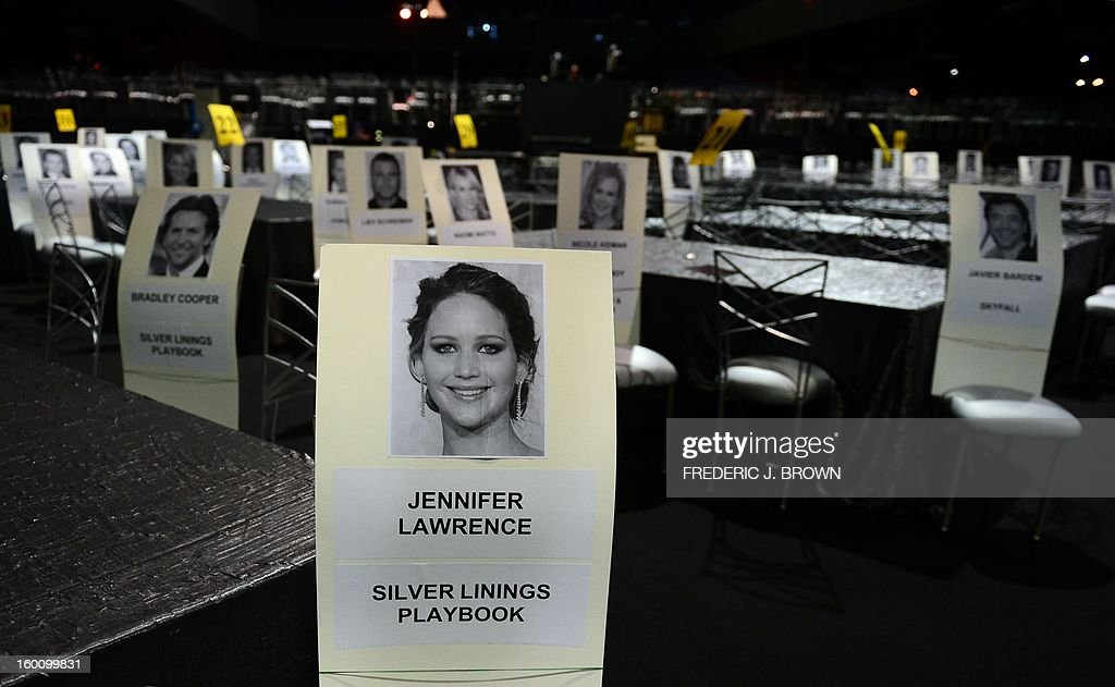 Portraits and names of the stars on cardboard placards are placed to mark their seats inside the Shrine Exposition Center in Los Angeles on January 26, 2013 during preparations ahead of the 19th Annual Screen Actors Guild (SAG) Awards on January 27. AFP PHOTO/Frederic J. BROWN