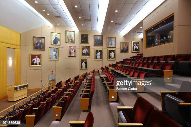 Portraits hang on the wall inside the Louis Bornstein Family Amphitheater at Brigham and Women's Hospital in Boston on June 12 2018 The portraits are...