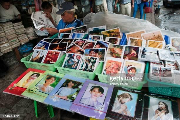 Portraits of Aung San Suu Kyi are sold on a Yangon sidewalk