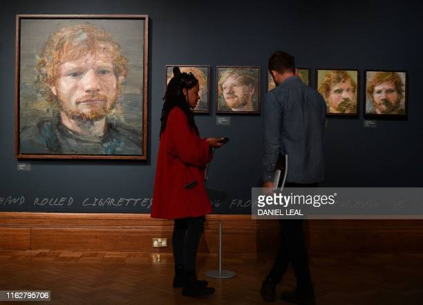 Portraits of British musician Ed Sheeran painted by Irish artist Colin Davidson are pictured on display during a press preview of the exhibition 'Ed...