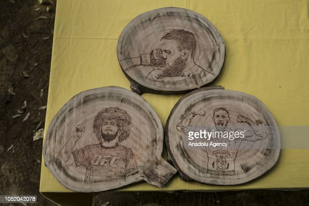 Portraits of Conor McGregor and Khabib Nurmagomedov burned on wood by cook Halil Bozkurt are seen in Turkey's Hatay on October 13 2018 Bozkurt uses...