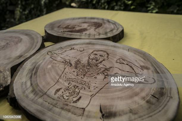 Portraits of Conor McGregor burned on wood by cook Halil Bozkurt are seen in Turkey's Hatay on October 13 2018 Bozkurt uses wood burning technique to...