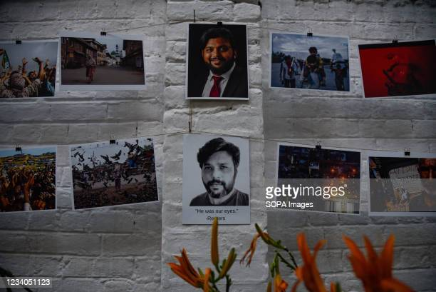 Portraits of Danish Siddiqui along with photographs shot by him are seen displayed during a candle light vigil in his remembrance in Srinagar....