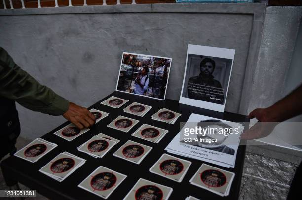 Portraits of Danish Siddiqui seen displayed during a candle light vigil in his remembrance in Srinagar. Reuters journalist Danish Siddiqui was killed...