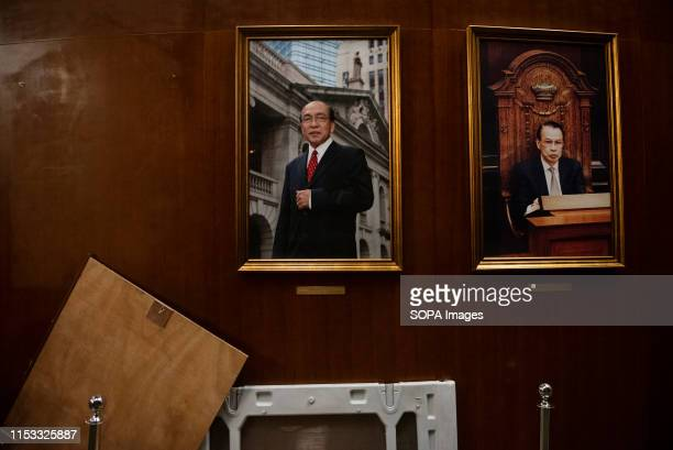 Portraits of former legislative leaders are damaged during the demonstration Hundreds of antigovernment protesters stormed into the legislative...