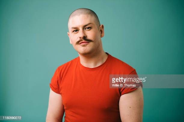 portraits of gay man - shaved head stock pictures, royalty-free photos & images