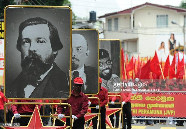 Portraits of German philosopher and social scientist Friedrich Engels, Russian communist revolutionary Vladimir Lenin, and Sri Lanka's Marxist JVP...