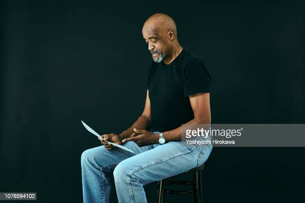 portraits of gospel musician who thinking through the score. - black trousers stock photos and pictures